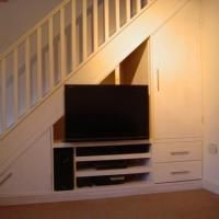 Under stairs tv unit under trappa pinterest tv units for Tv showcase designs under staircase