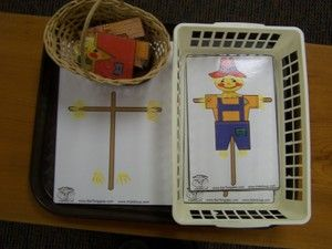 This is a really cute scarecrow activity that I downloaded and printed from Kidssoup.  To do this work, the child uses the blank (sticks only) board and the pieces (in the little basket) to make one of the scarecrows on the control cards (which are in the larger basket).  They have really enjoyed this work so far.