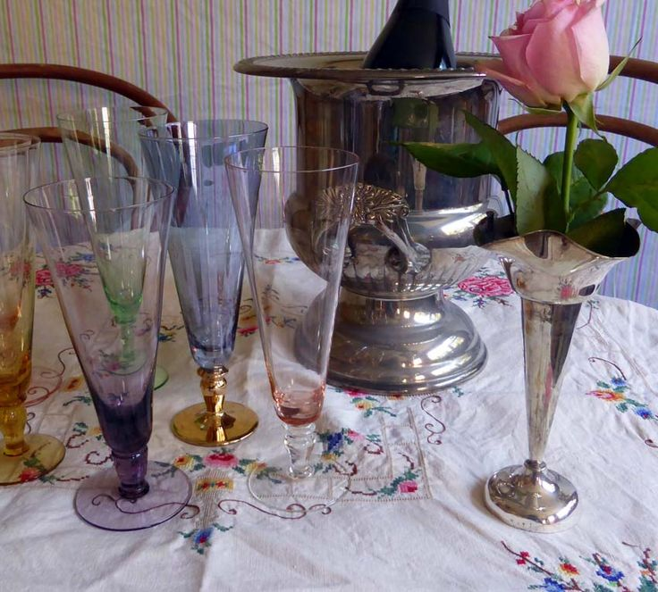 Silver champagne bucket, vase and colourful champagne flutes.