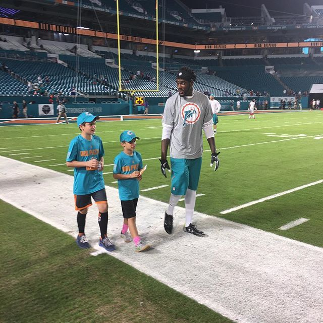Before every game, home or away, Chris McCain picks two young fans, brings them onto the field and introduces them to their favorite miami dolphins players (12/14/2015)