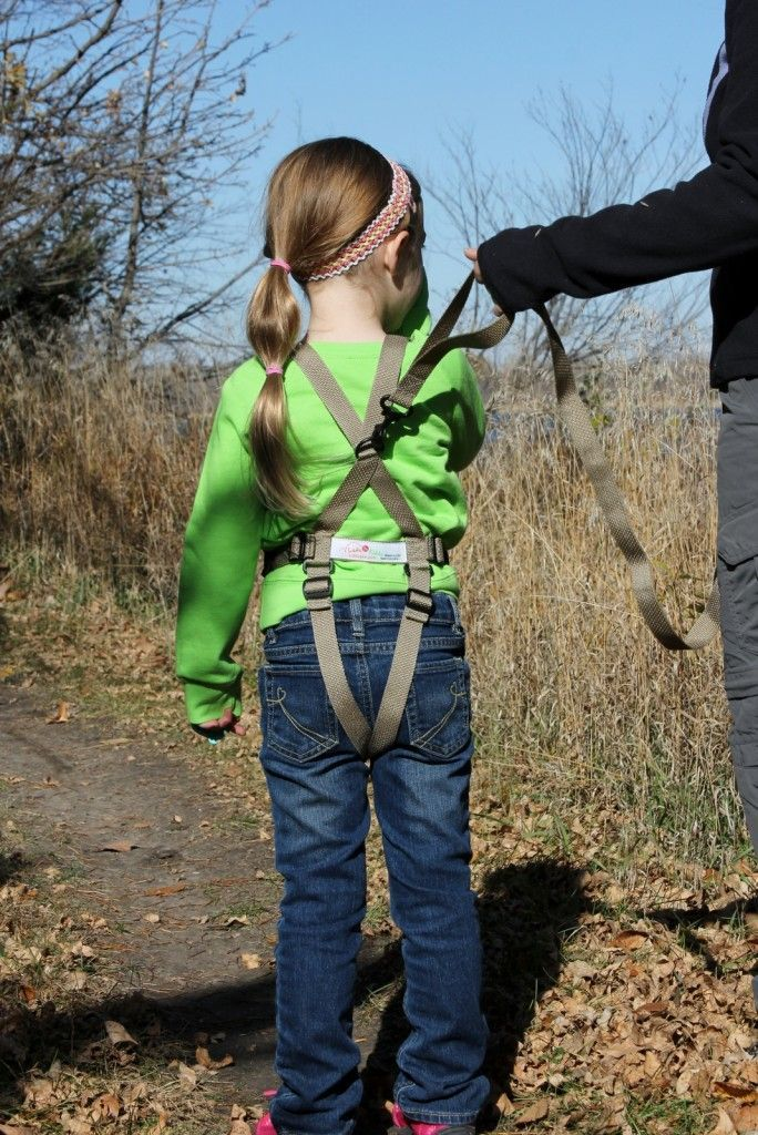 Rear view of the Let's Go Kiddo Activity Harness in tan