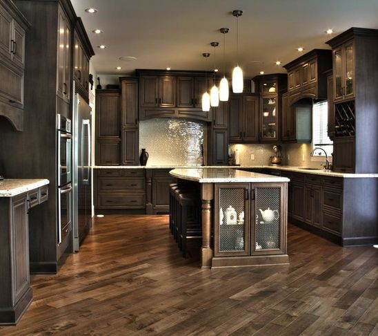Exclusive Brownstone. Dark Kitchen Cabinets/Herringbone floor.