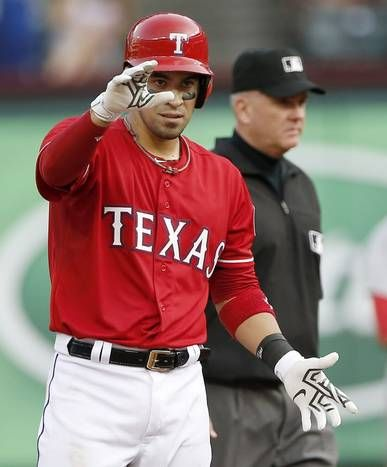 Texas Rangers Robinson Chirinos celebrates a 2 RBI double during the fourth inning of a baseball game against the Boston Red Sox, Saturday, May 30, 2015, in Arlington, Texas. (AP Photo/Brandon Wade)