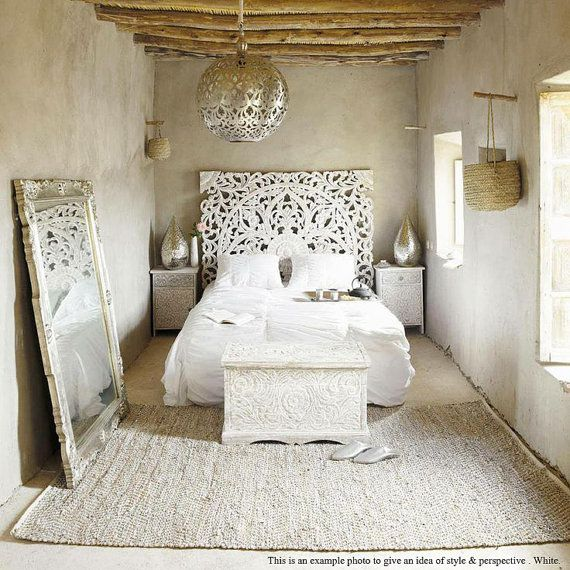 I love the Thai headboard.  Also really like the simple chunky woolen rug.