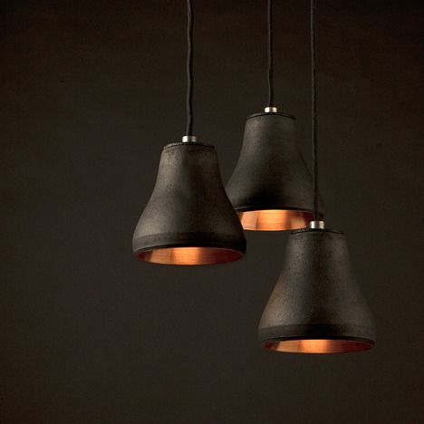 Schwarzes gold pendant light by Ingo Schuppler made of charcoal (+ flour + water + copper).