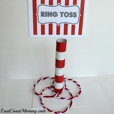 This site has a bunch of fantastic DIY carnival games and activities... including this ring toss made from an paper towel roll and some pipe cleaners.