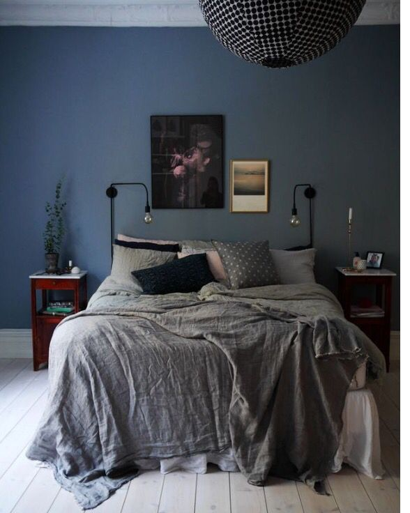 Bedroom Idea with Blue Wall and White Wood Floor. This hue of blue looks great with black accessories
