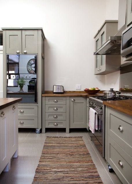 Swedish Style freestanding kitchen by Milestone Kitchens. The colour of the Island is Dulux Dusted Moss 2 and the colour of all the other units is Dulux Dusted Moss 1.