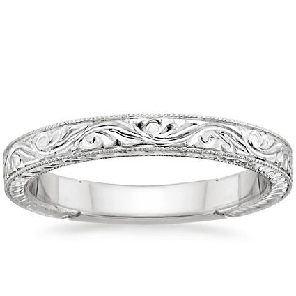 This beautiful vintage-inspired ring is hand-engraved with ornate scrolls and delicate milgrain on the top and sides of the band for a beautiful light-catching effect. A sizing bar in the back allows for future adjustments.