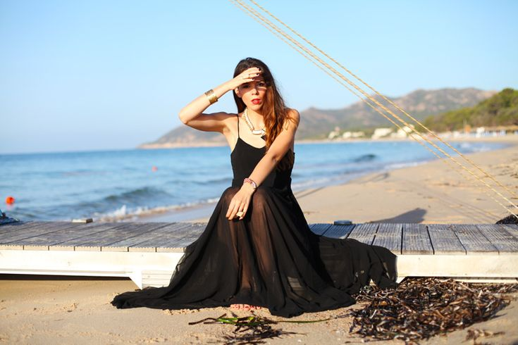 A transaperent black maxi dress is a holiday essential!