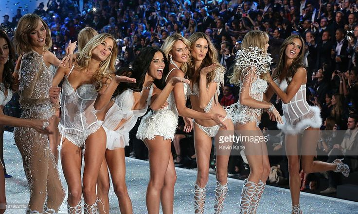 Models Karlie Kloss, Doutzen Kroes, Adriana Lima, Candice Swanepoel, Behati Prinsloo, Lindsay Ellingson and Alessandra Ambrosio walk the runway at the 2013 Victoria's Secret Fashion Show at Lexington Avenue Armory on November 13, 2013 in New York City.