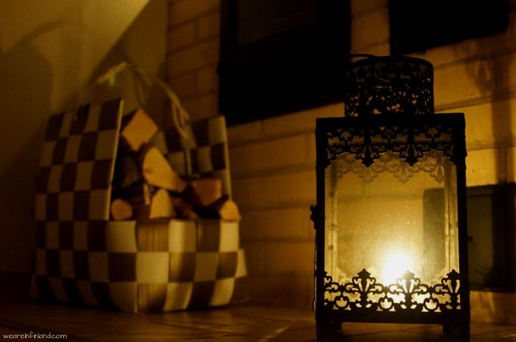 Chunks of wood in a basket in front of a brick oven fireplace. #winter #Finland #candles