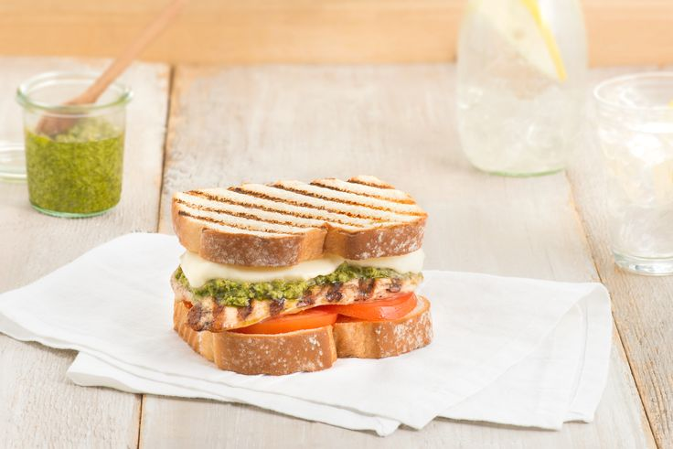 Grilled Chicken Caprese with Basil Pesto - Fresh mozzarella, basil and tomato add an Italian flair to this chicken sandwich.