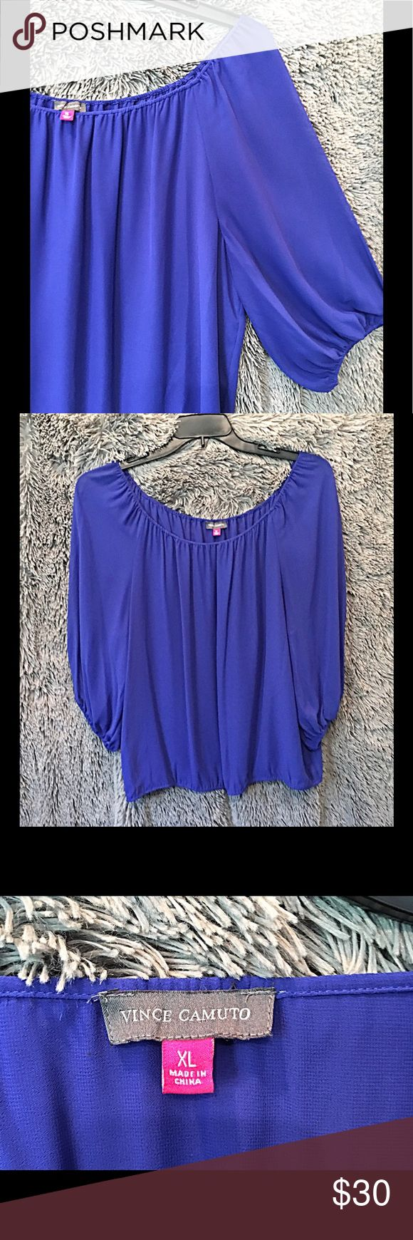 👋🏻 Vince Camuto Royal Blue Blouse This Vince Camuto royal blue blouse is 100% polyester.  While somewhat sheer, the top is lined with the same material, so there is no show-through.  There is elastic around the bottom of the 3/4 sleeves and also the bottom of the blouse - but it does not cause the blouse to bunch up, it hangs nicely.  Very gently used, in beautiful condition. Vince Camuto Tops Blouses
