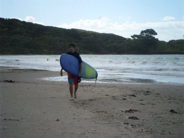 Surfing coopers beach New Zealand