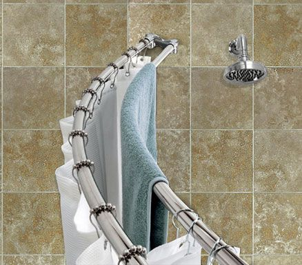 Hang two shower curtain rods in the shower- one for the shower curtain and one for towels. I did this with a tension rod over shower head for dripping bathing suits and extra towels.