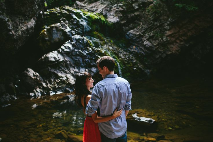 A summer engagement session, captured at the base of the uppermost waterfall in Victoria Park in Truro, Nova Scotia.