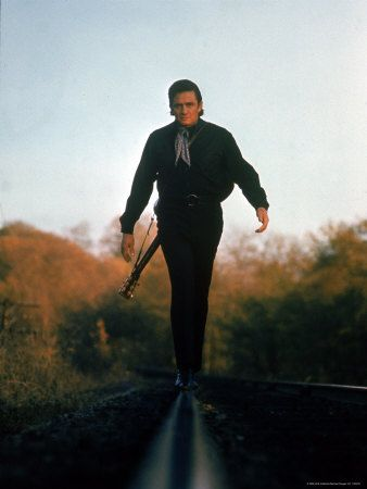 Country Music Star Johnny Cash Walking Along Line of Railway Track with His Guitar Premium-Fotodruck