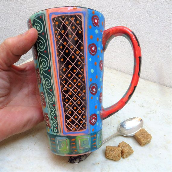 Pure pattern and brilliant colour on this tall ceramic mug