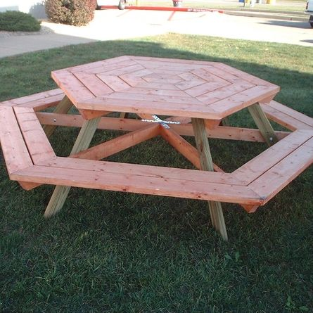 This hexagonal picnic table created from standard lumberyard materials keeps everyone at the center of the conversation! | thisoldhouse.com/yourTOH