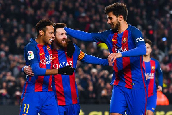 Lionel Messi (C) of FC Barcelona celebrates with his team mates Neymar Jr. (L) and Andre Gomes after scoring from the penalty spot his team's second goal during the Copa del Rey quarter-final second leg match between FC Barcelona and Real Sociedad at Camp Nou on January 26, 2017 in Barcelona, Catalonia.