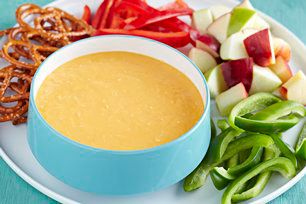 See how shredded cheddar and VELVEETA team up with white wine and dry mustard to make this creamy cheese fondue recipe a glorious dip.