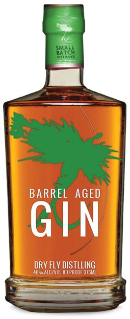 Dry Fly Barrel Aged Gin. 40 % ABV. Aged. One year aged version of the regular gin. With the same botanical deck, it is aged in a wheat whiskey barrels on second use. This aging is typically longer than most aged gins and results in a softer, rounded version of the original gin with a bit of blonde color.