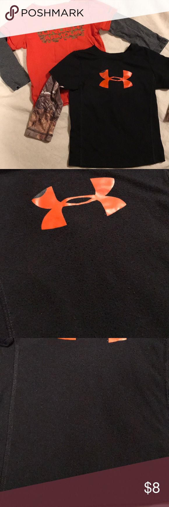 Set of Baby boy Under Armour Long sleeve Used condition, still have lots of life left.   Black one is piling on the black. Camo isn't. Front orange logo has peeled on the top left corner (pictured)   Orange- vinyl has peeled off on the back (pictured), front has cracked in a few places but not peeling.   Both are all season gear.   Bundle and save! Under Armour Shirts & Tops Tees - Long Sleeve