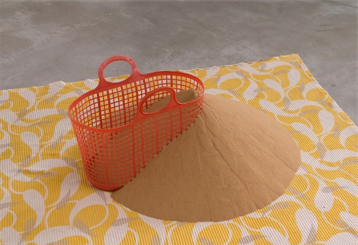 Drora Dominey- Sand More Sand, 2010, sand, basket, fabric.