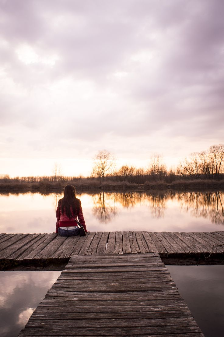 Contemplative girl in sunset #red #jacket #sunset #girl #lake #still #life #sitting #pier