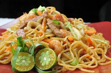 """Pancit Canton"" is egg noodles sauteed in chicken liver, gizzard and shrimp with crispy vegetables. [image from: http://dld.bz/dfx7Q]  Treat yourselves with this dish today only at The Original Barrio Fiesta Restaurant - Dubai. See you there! #UAE #Dubai"
