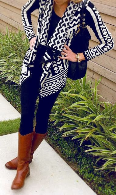 Stylish printed black and white cardigan with leather long boots: