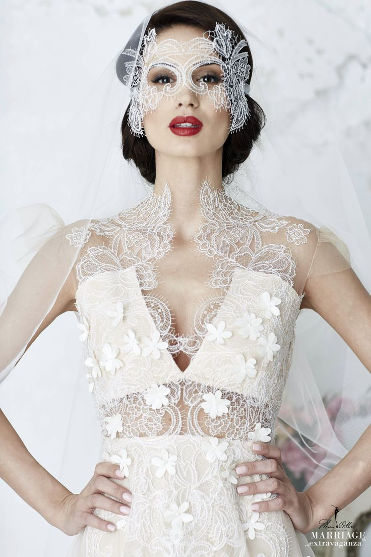 """Marie Ollie, Marriage ,,extravaganza"""", wedding dress, lace details, flowers spread"""