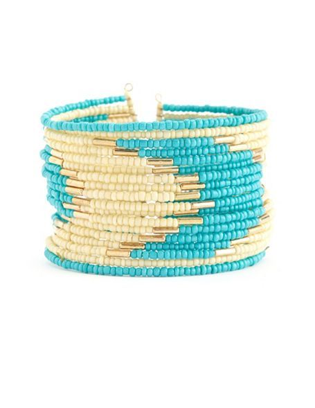 Waves of seed bead color are separated by small bugle beads:  Tribal Seed Bead Cuff Bracelet