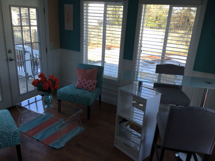 Exciting for my sunroom to finally come together with teal and coral accents!  #home #decor #teal #coral #house #sunroom