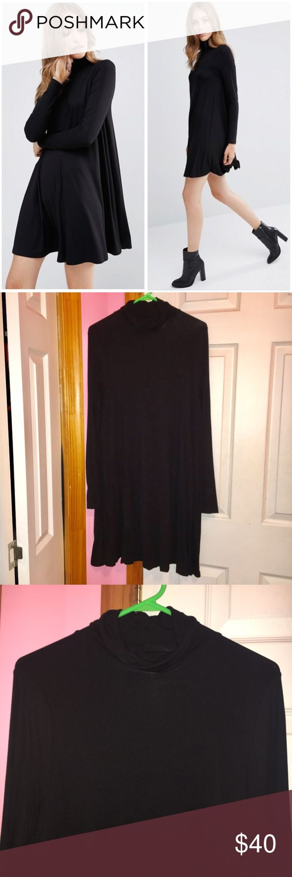 """✨SALE✨ ASOS Turtleneck Swing Dress Sale price is firm so no offers will be accepted. Only worn once. Swing dress with a turtleneck. Long sleeves. Loose fit. 92% viscose and 8% elastane. Laying flat dress is approx 35"""" in length and bust is approx 38"""". Stock photos from ASOS. ❌NO TRADES❌ ASOS Dresses"""