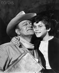John Wayne and his son Ethan enjoying a hug while filming Big Jake 1971