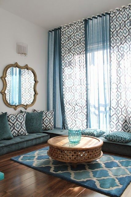 Love the low furnishings with floor to ceiling window treatment!
