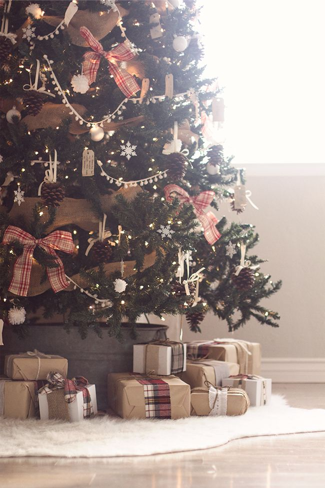 Christmas tree decor made from pine cones, scrap ribbon and hang tags, etc. Presents wrapped with kraft paper and tied with fabric and ribbon scraps. LOVE!!!! from Jenna Sue: Christmas Home Tour Part 1