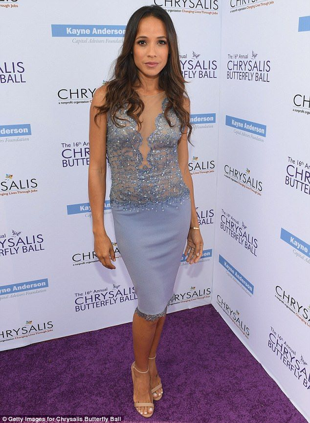 Glittering: Dania Ramirez slipped on a lace light blue textured dress, adding neutral strappy heels and wavy tresses
