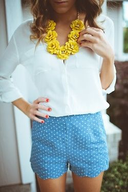 All the little details make this a great outfit for a shoot. Scalloped shorts, dainty polka dots, statement necklace, red nails, and loose waves in the hair.