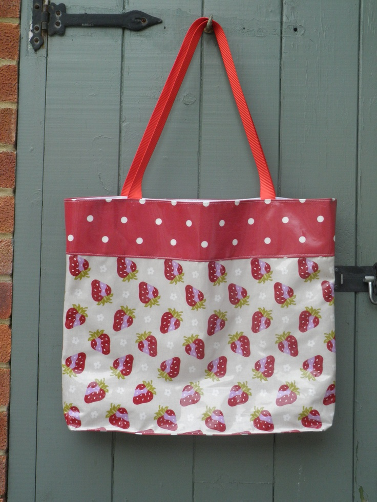 Strawberry Picking oilcloth holiday tote, fully lined, with contrast spot base and top. From www.etsy.com/shop/dagenaisdesign