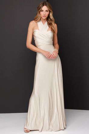 """Any which way you wrap it, the Always Stunning Convertible Beige Maxi Dress is one amazing dress! Two, 82"""" long lengths of fabric sprout from an elastic waistband and wrap into dozens of possible bodice styles including halter, one-shoulder, cross-front, strapless, and more. Stretchy beige fabric has a satiny sheen, and a full length maxi skirt pairs perfectly with any choice you make up top. Unlined. 94% Polyester, 6% Spandex. Hand Wash Cold. Made with Love in the U.S.A. Want Styling Tips?…"""
