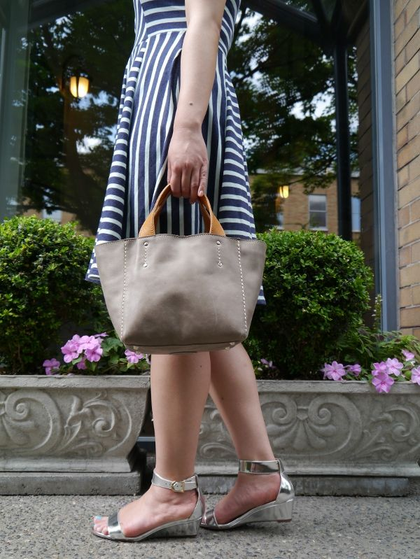 Stripes with a neutral little tote and metallic silver wedge sandals