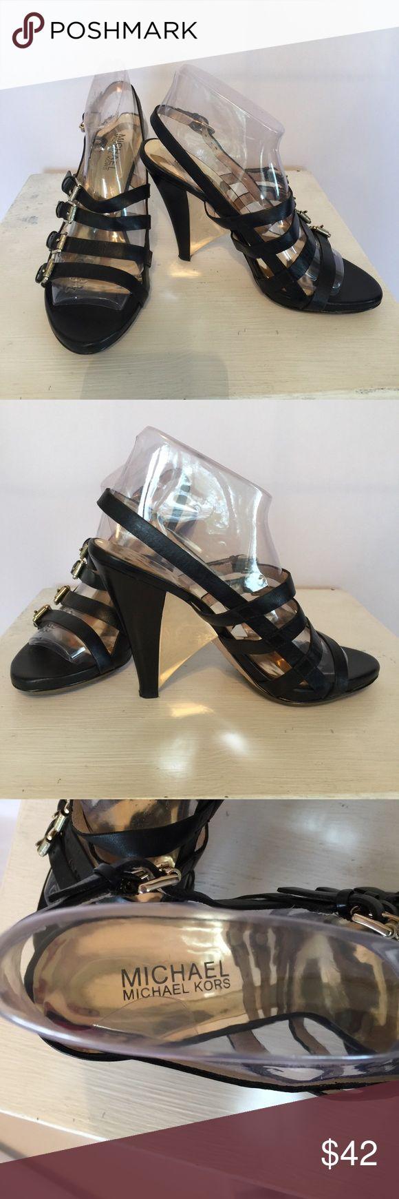 "Michael Kors Black Strappy Heels Michael Kors Black Strappy Heels with gold buckles and a shiny gold wedge. Heel is 4 1/2 "" High. Beautiful shoes.  Worn very little. Michael Kors Shoes Heels"