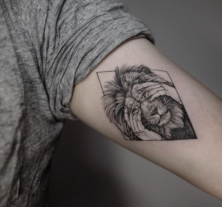 cool lion with cover face hands tattoo idea by @mirmandainks