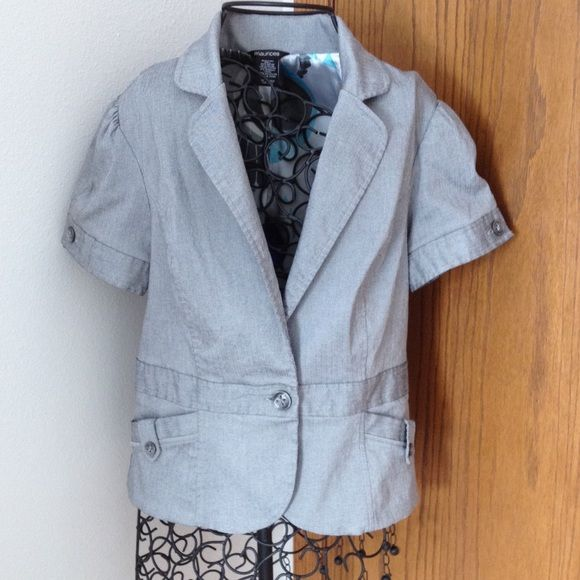 """Gray lined short sleeve button up stretchy jacket. Lined short sleeve jacket. One bottom opening, two pockets. Seaming detail, button loop on back and pockets. Button opening on sleeve. Length is 22"""". Very nice gently worn. Silver gray color. Close fitting. Maurices Jackets & Coats"""