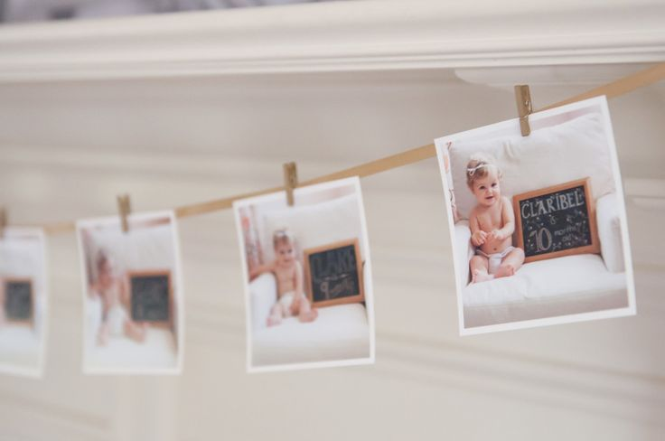 Use clothesline to display monthly photos at first birthday - simple and chic! #firstbirthday