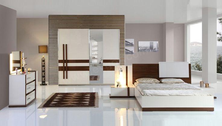 Cemre Modern Yatak Odası Takımı E1 Standartlarına Uygun Parlak Suntalemden Oluşmaktadır.    Cemre Yeni Model Yatak Odası Takımının Gardrop Kapakları Sürgülü Kapak Olup MDF Üretimdir.
