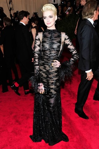 Anne Hathaway revealed a new platinum blonde hair colour and wore a vintage Valentino sheer dress.